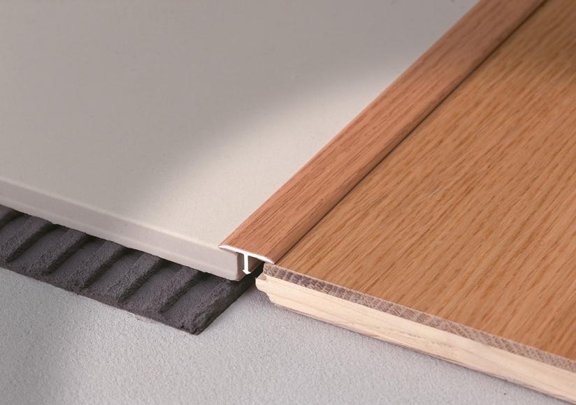 Profilo di raccordo con funzione coprisoglia, Covertec SP, finitura effetto legno, rovere
